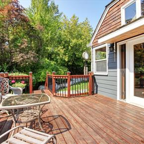 Hardwood deck with glass-topped table and patio couch