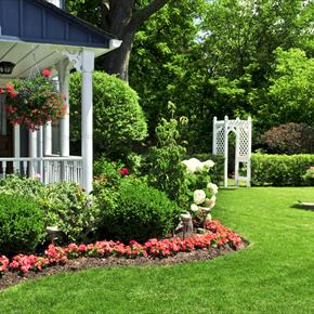 Front porch and landscaping with arbor