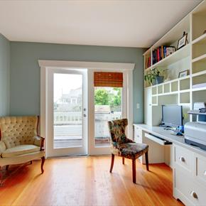 Home office with built-in wall unit and exterior door