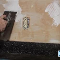 Spread adhesive with trowel