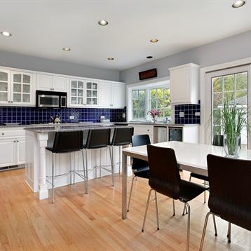 Royal blue tile backsplash set against white kitchen cabinets