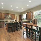 Spacious transitional kitchen with island and dining table