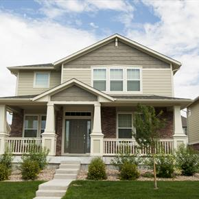 Two story bungalow style house with front porch
