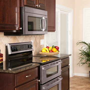 Kitchen Cooking Area with Electric Range and Granite Countertops