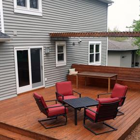 Wood deck with red pleather outdoor furniture